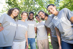 Happy volunteers in the park Royalty Free Stock Image