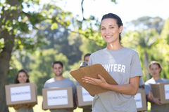 Happy volunteers in the park Royalty Free Stock Photos