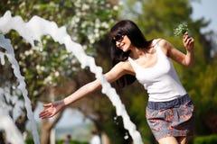 Happy vomen near the fountain Royalty Free Stock Photography