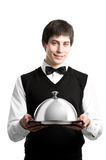 Happy waiter with cloche lid cover. Cheerful waiter srvant with metal cloche lid cover Stock Images