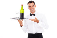 Waiter tray wine. Happy waiter holding tray of wine and glass Royalty Free Stock Photos
