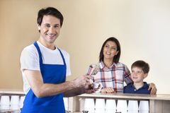 Happy Waiter Serving Ice Cream In Cup Royalty Free Stock Photos