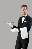 Happy waiter with tray. Professional waiter serving with empty stainless tray, perfect for your product stock image