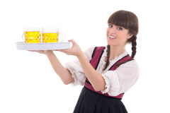 Happy waitress in bavarian dress with beer Royalty Free Stock Images