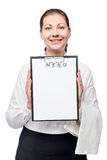 Happy waitress with a blank menu entry on a white Royalty Free Stock Photos