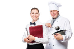 Happy waitress and chef with cooking utensils on a white backgro Royalty Free Stock Photography