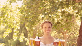 Happy waitress holding pints of beer stock video footage
