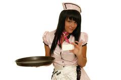 Happy waitress holding tray with a blank card Stock Photo