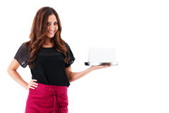 Happy waitress holding tray with a blank card Royalty Free Stock Images