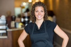 Happy Waitress Standing In Cafe Royalty Free Stock Photography
