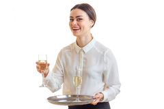 Happy waitress in uniform smiles on camera Royalty Free Stock Photography