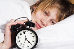 Happy waking. A happy woman waking at 5 o'clock in the morning, expecting a happy new day Royalty Free Stock Images