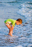 Happy walking child on the sea Stock Image