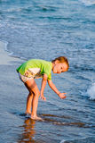 Happy walking child on the sea Royalty Free Stock Images