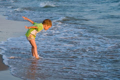 Happy walking child on the sea stock photo