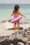Happy walking child on the sea. Beach royalty free stock photos