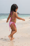 Happy walking child on the sea. Beach stock images