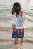 Happy walking child on the sea. Beach stock image