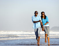 Happy walking couple Royalty Free Stock Photography