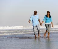 Happy walking couple stock photography