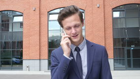 Happy Walking Young Businessman Talking on Phone, Outdoor stock video