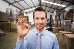 Happy warehouse manager making okay gesture Stock Photo