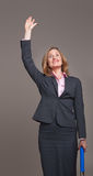 Happy waving businesswoman Stock Images