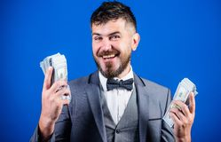 Happy and wealthy. Rich businessman with us dollars banknotes. Bearded man holding cash money. Currency broker with. Bundle of money. Making money with his own royalty free stock images