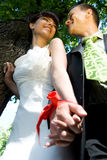Happy wedding couple. With related hands are smiling Royalty Free Stock Image