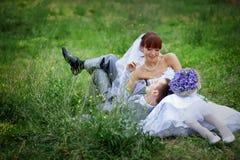 Happy wedding couple Stock Photos