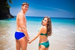 Happy wedding couple on the beach Stock Images