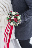 Happy wedding couple with bouquet outdoors on winter day, closeup Royalty Free Stock Photos