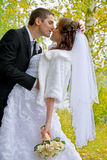 Happy wedding couple. Bride and Groom kissing in the park Stock Photo
