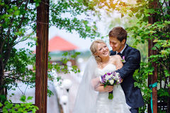 Happy wedding couple bride and groom in park Royalty Free Stock Image