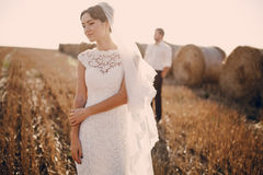 Happy wedding couple in a field Royalty Free Stock Photography