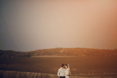 Happy wedding couple in a field royalty free stock photo