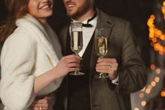 Happy wedding couple with glasses of champagne stock image