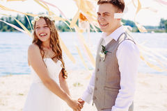 Happy wedding couple laughing Royalty Free Stock Images