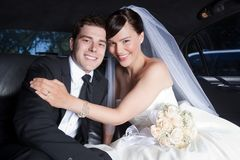 Happy Wedding Couple in Limo Royalty Free Stock Photography