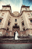 Happy wedding couple outdoor with old building behind Stock Photo