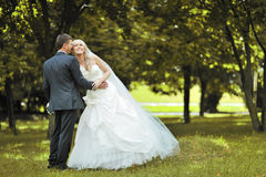 Happy wedding couple outdoors Royalty Free Stock Photos