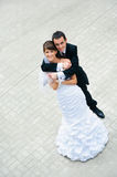 Happy wedding couple standing and embracing Stock Photography