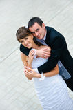 Happy wedding couple standing and embracing Stock Image
