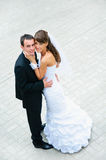 Happy wedding couple standing and embracing Stock Images