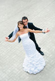 Happy wedding couple standing and holding hands Stock Photography