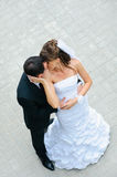 Happy wedding couple standing, kissing and embracing Stock Images