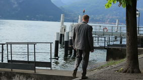 Happy wedding couple walking on the berth in Como, Italy stock video