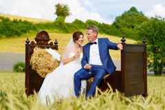 Happy wedding couple in wheat field Royalty Free Stock Images