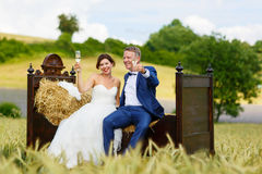 Happy wedding couple in wheat field Stock Photos