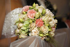 Happy wedding day. Bridal bouquet focus on the flowers, Photo taken in the Church Stock Image